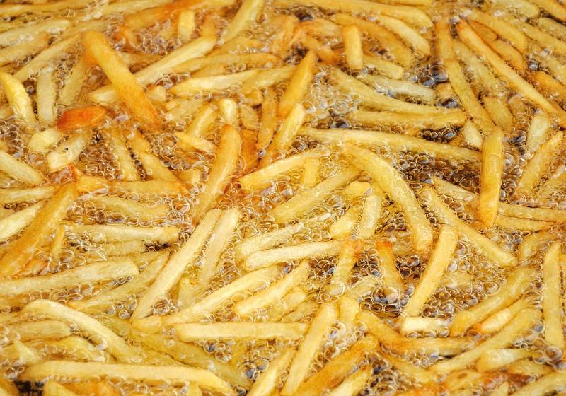 french fries frying with a deep fryer